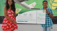 Fly Jamaica hands over tickets