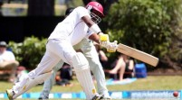 Bravo honours Mandela with resistance stand; scores double century in West Indies fight back