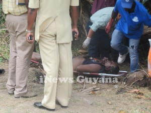 Undertakers prepare to remove the body of murdered businessman, Rajendra Singh.