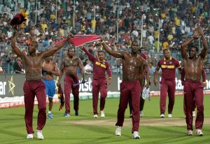 West Indies's players led by captain Darren Sammy(C)celebrate after victory in the World T20 cricket tournament final match between England and West Indies at The Eden Gardens Cricket Stadium in Kolkata on April 3, 2016.   / AFP / Dibyangshu SARKAR        (Photo credit should read DIBYANGSHU SARKAR/AFP/Getty Images)