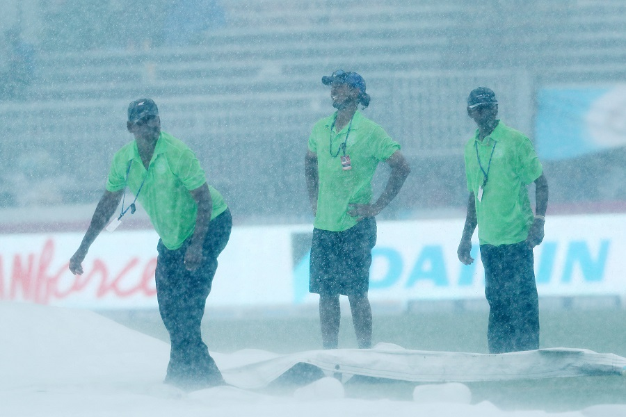 Ground staff work on the pitch during the rain break during the 2nd international T20 Trophy match between India and the West Indies held at the Central Broward Stadium in Fort Lauderdale, Florida, United States of America on the 28th August 2016 Photo by:  Ron Gaunt / BCCI/ SPORTZPICS