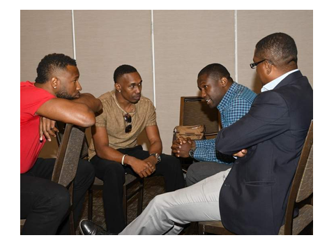 FACE-TO-FACE: West Indies Cricket Board president Dave Cameron, right, and West Indies Players Association president Wavell Hinds, second right, discuss a number of issues including the relationship between the WICB and its players with T20 stars Kieron Pollard, left, and Dwayne Bravo in Florida, USA, on Wednesday. —Photo: WICB Media