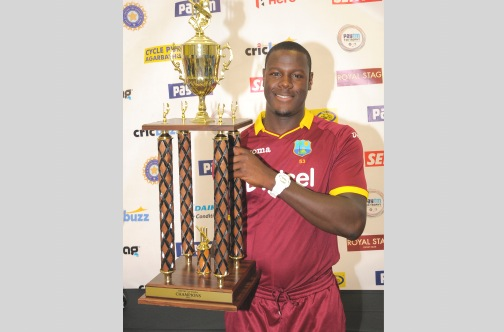 Newly appointed West Indies T20 captain Carlos Brathwaite shows off the Paytm trophy after his team copped the two-match series against India 1-0, after the second match at Central Broward Stadium yesterday ended in a no-result, as heavy rain forced the abandonment of play. West Indies had won the first game on Saturday by one run. (Photo: AFP)