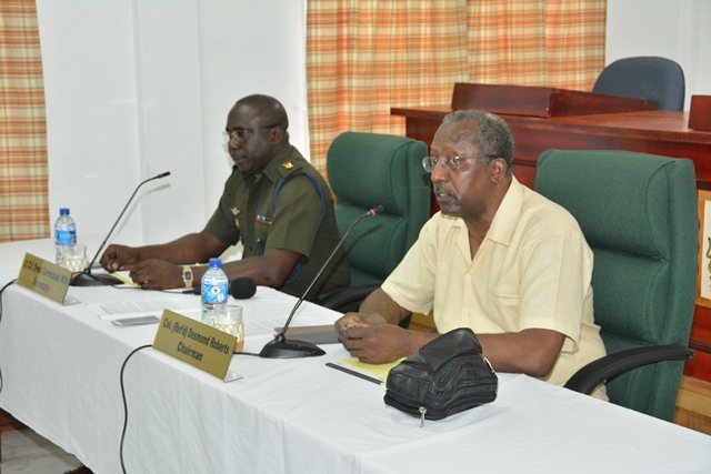 Chairman of the Commission, Col. (Ret'd) Desmond Roberts and Secretary to the Commission, Col. Denzil Carmichael during the press conference at the Department of Public Service
