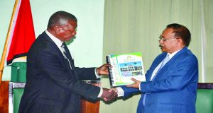 Flashback: Deodat Sharma, Auditor General of Guyana, handing over the 2014 Auditor General's Report to Dr Barton Scotland, Speaker of the National Assembly