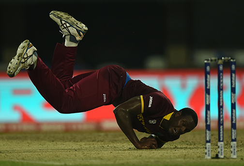 West Indies's Carlos Brathwaite fields a ball during the World T20 cricket tournament final match between England and West Indies at The Eden Gardens Cricket Stadium in Kolkata on April 3, 2016.   / AFP / INDRANIL MUKHERJEE
