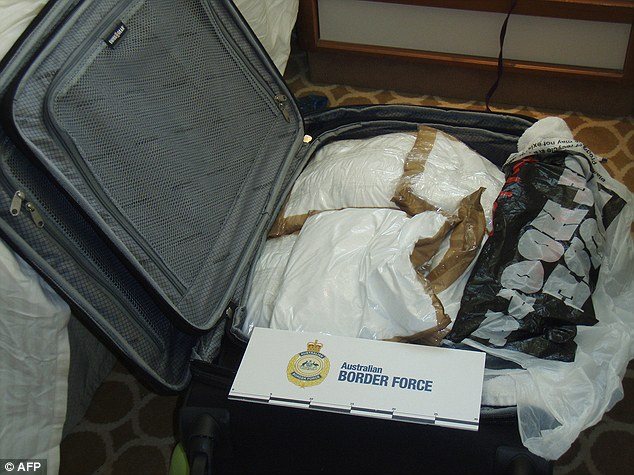 Pictured is one suitcase filled with cocaine which allegedly belonged to the trio (AFP photo)