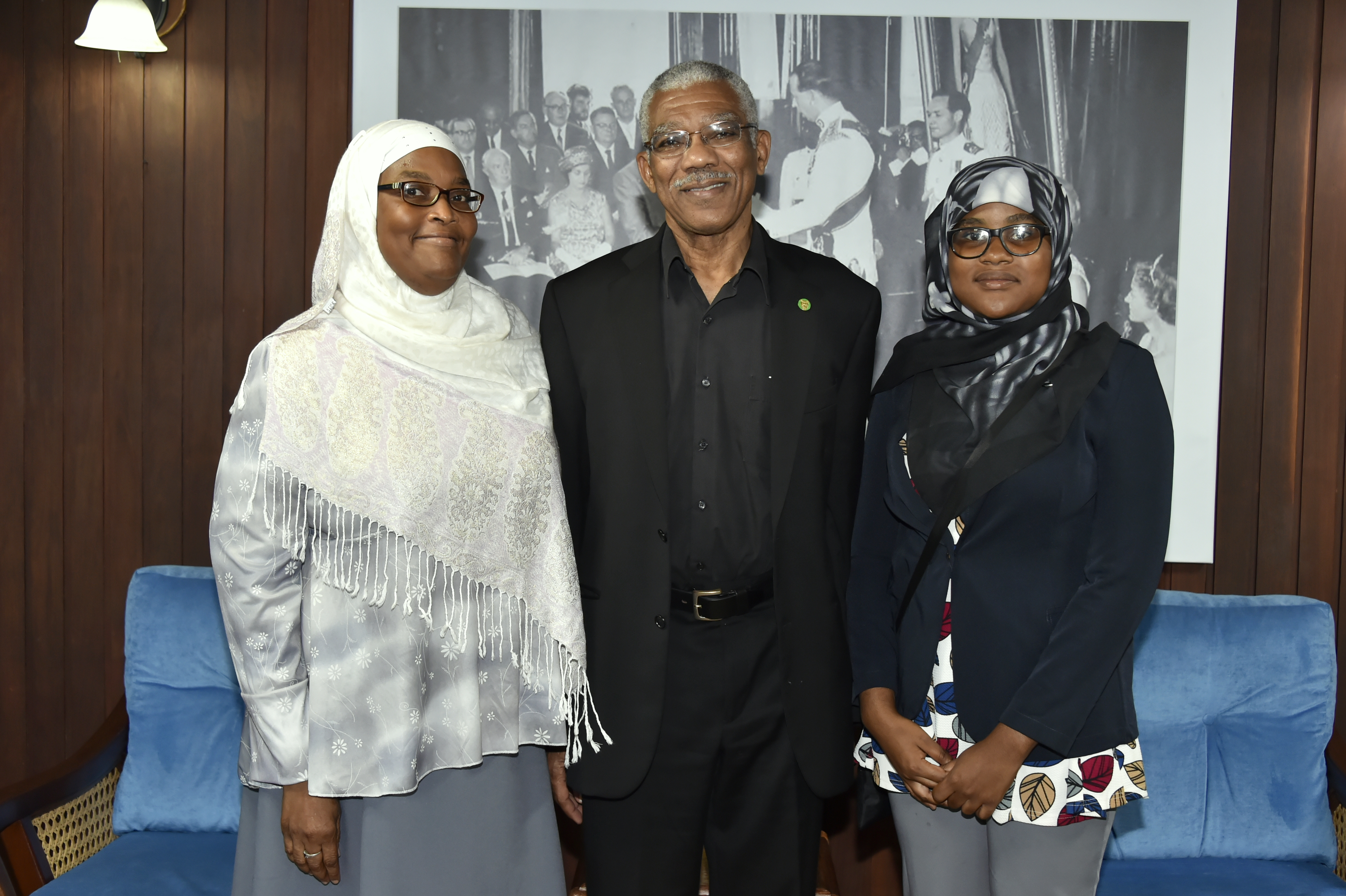 President David Granger flanked by Ms. Fatima Karim and her mother Ms. Khadijah Karim at the Ministry of the Presidency
