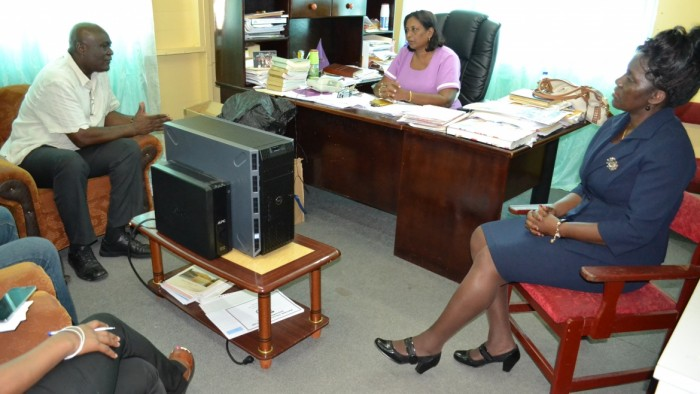 Chief Executive Officer of the eGovernment Agency, Mr. Floyd Levi met with the Regional Education Officer, Mrs. Baramdai Seepersaud (centre) to discuss the progress of the Secondary Schools Connectivity Project, which is part of the IDEAL programme