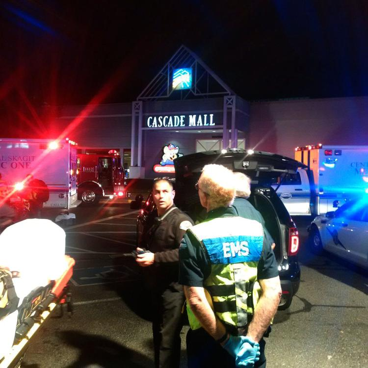 Police escort EMS personnel into the mall just before midnight, about five hours after the incident began. (SGT. MARK FRANCIS VIA TWITTER)