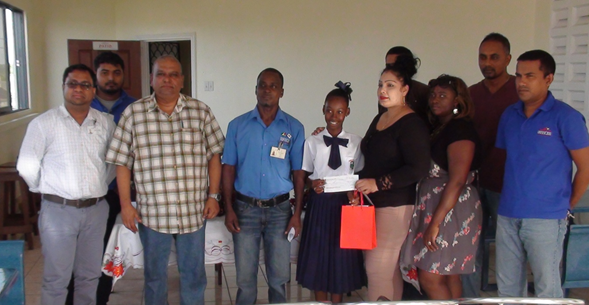 Mrs. Bibi F. Alli, Administrative Assistant/ Social Coordinator, of BBCI handing over A Bursary award to Ms. Crystal Mc Pherson BBCI'S top grade six student 2016.