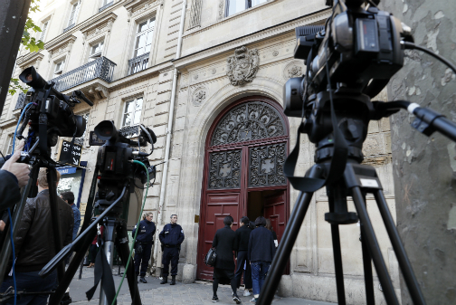 Cameras are set up as police officers stand guard at the entrance to a hotel residence at the Rue Tronchet, near Madeleine, central Paris, on October 3, 2016, where US reality television star Kim Kardashian was robbed at gunpoint by assailants disguised as police who made off with millions, mainly in jewellery. (Photo: AFP)