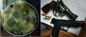 The firearm, ammo and 'ganja' found during the raid