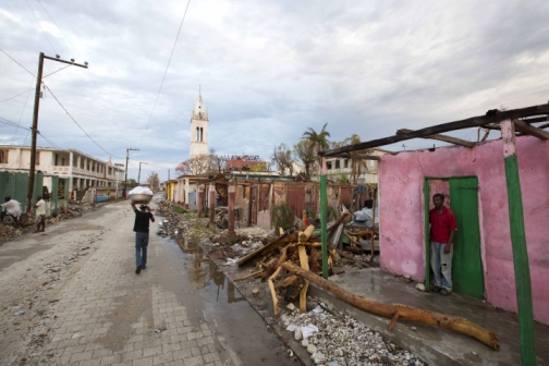 In this Wednesday, Oct. 19, 2016 photo, Clony Toussaint stands in the doorway of his home, damaged by Hurricane Matthew, in Port-a-Piment, a district of Les Cayes, Haiti. Wednesday Oct. 19, 2016.(Photo: AP)