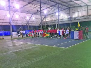 The teams stand at the opening ceremony for the singing of their National Anthems of each nation