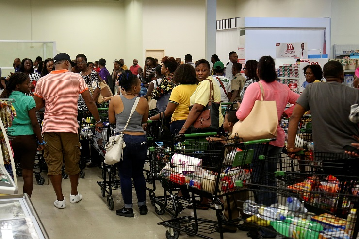 Jamaicans stock up with supplies at a supermarket ahead of the arrival of Hurricane Matthew. (Photo credit: BBC)