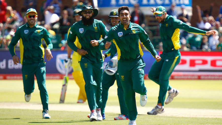 South Africa's bowler Tabraiz Shamsi (C) celebrates after taking a wicket during the fourth One Day International (ODI) between South Africa and Australia at the St. George's Park cricket stadium on October 9, 2016 in Port Elizabeth. / AFP / MICHAEL SHEEHAN        (Photo credit should read MICHAEL SHEEHAN/AFP/Getty Images)