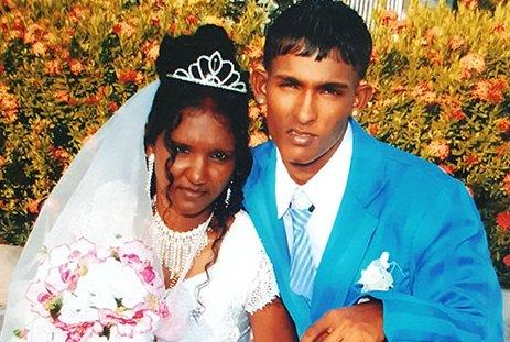 "Roland ""Vishal"" Jodmie and his wife Tarmattie Kumar and on their wedding day"