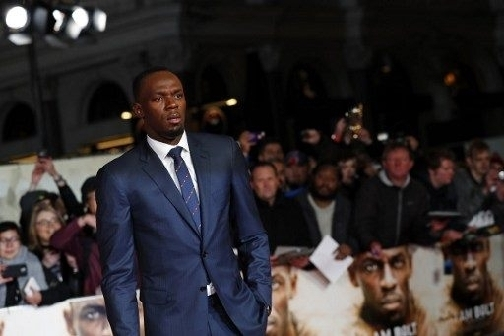 Jamaican athlete Usain Bolt arrives to attend the World Premiere of the film