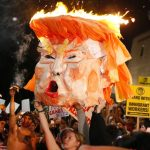 Protesters set an effigy of Donald Trump afire outside Los Angeles City Hall on Wednesday, November 9. Tens of thousands rallied in at least 25 US cities to protest Trump's unexpected victory in the divisive 2016 presidential election.