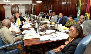 President David Granger (fifth from right) and Members of his Cabinet being briefed by the Chief Executive Officer of the Guyana Sugar Corporation (GuySuCo) Mr. Errol Hanoman, at Cabinet meeting today.