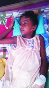 Seven-year-old Padmini Patram lies helpless on her bed