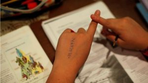They spend longer hours bent over their homework, but does it amount to better results for Spanish students? (Reuters)