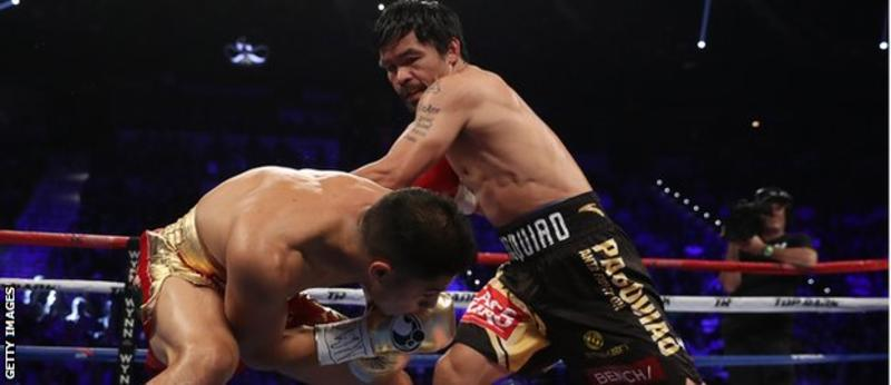 "Pacquiao was landing punches as the Las Vegas crowd chanted ""Man-ny! Man-ny!"" (Getty Images)"