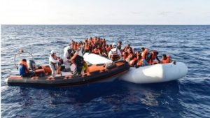 Migrant boats, such as this one on the left, are often packed full of people (AFP photo)