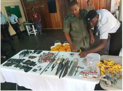 Joint Services members going through the contraband seized this morning at the Georgetown Prison