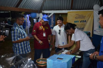 Minister of Indigenous Peoples Affairs Sydney Allicock taking a look at a local product at the 16th Rupununi Expo