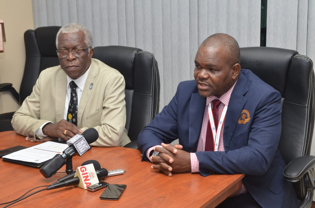 Director General of the Guyana Civil Aviation Authority (GCAA) Egbert Field (L)and Courtney Frank, Training Officer of the GCAA, speaking at the press briefing at Kingston.
