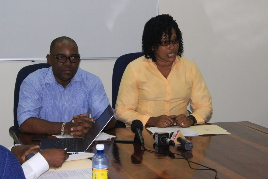 DHBC General Manager, Rawlston Adams (L) and Junior Public Infrastructure Minister Annette Ferguson (R)