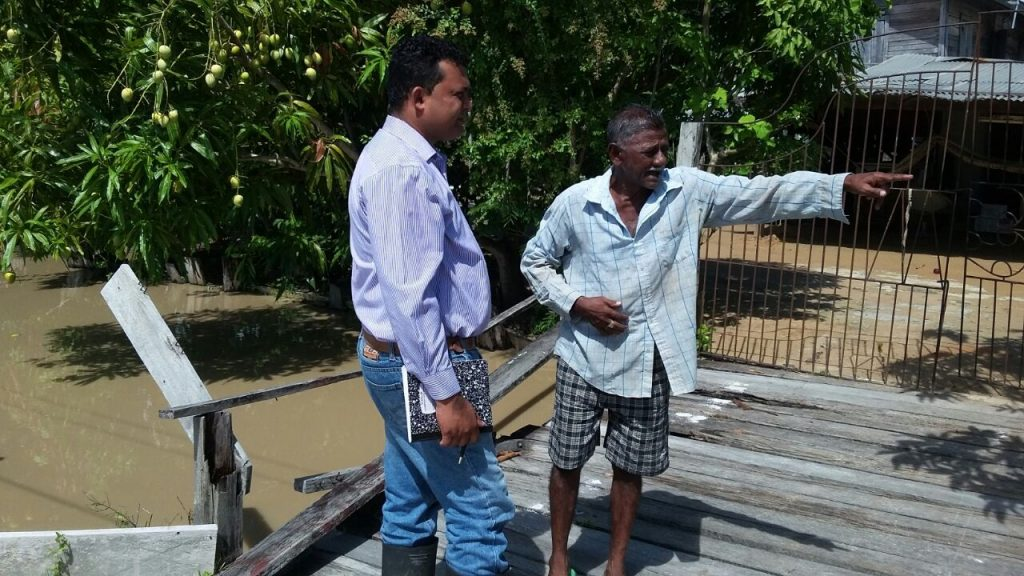 Daveanand Ramdatt visiting residents of his Region affected by flooding
