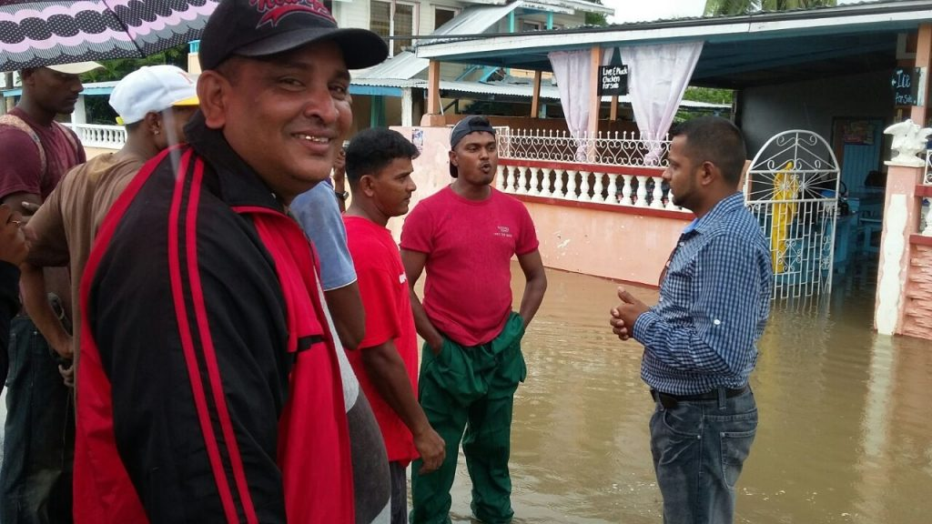 Vickchand Ramphal,visiting residents of his Region affected by flooding