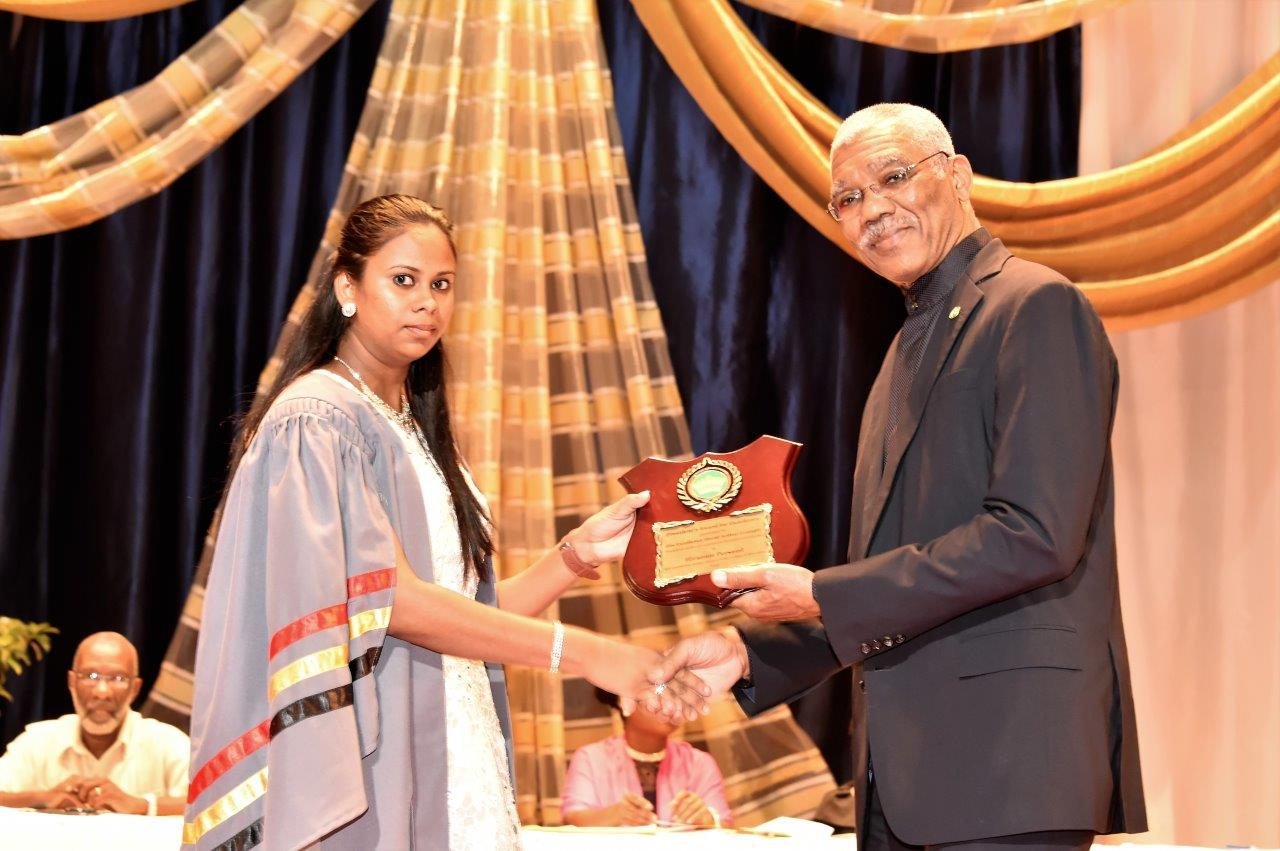 Best Graduating Student of the Class of 2016, Ms. Hirannie Persaud receiving the President's Prize from President David Granger.