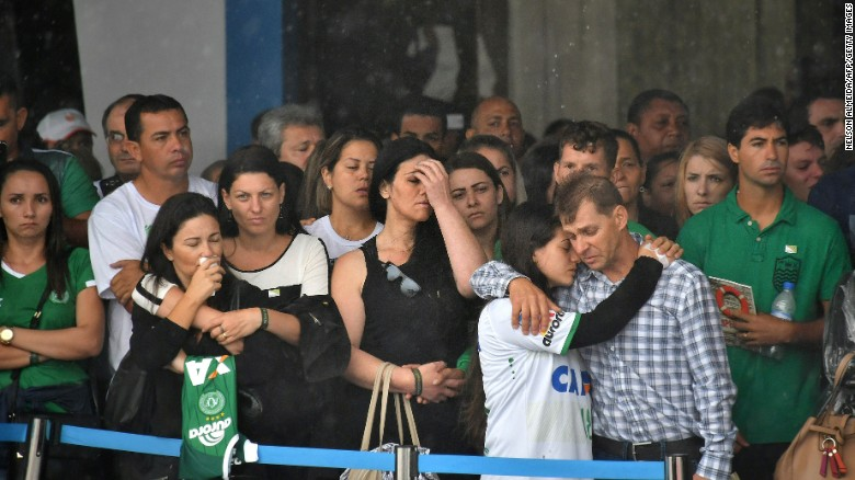 Relatives of the players wait for the arrival of the bodies at the Chapeco Airport on December 3.