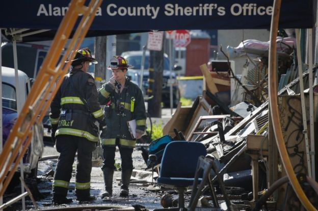 Firefighters are struggling through piles of debris to reach the bodies of those killed in the warehouse fire (Getty Images)