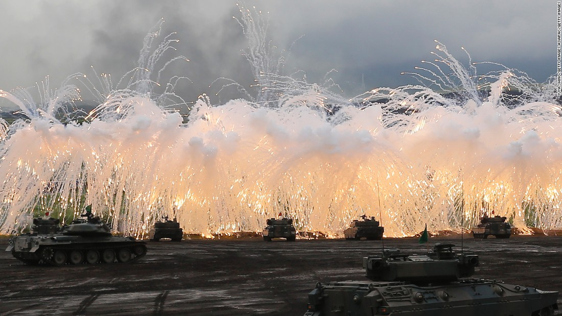 Japan Self-Defense Force tanks and other armored vehicles take part in an exercise at the military's East Fuji Maneuver Area on August 25, 2016, in Gotemba, Japan. Japan has one tank division and three armored infantry divisions.