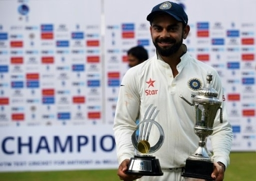 Virat Kohli celebrates after leading India to a 4-0 Test series win against England on December 20, 2016 (Photo: AFP)